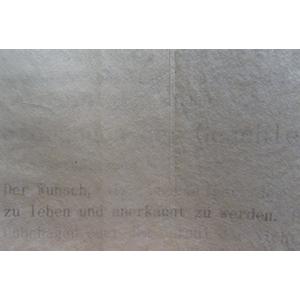 Bild verlinkt zum Buch m_ein Körper.  das Bild zeigt Schichten transparenten Papiers. Unter dem Papier kann man schwach lesen: der Wunsch, zu leben und anerkannt zu werden.